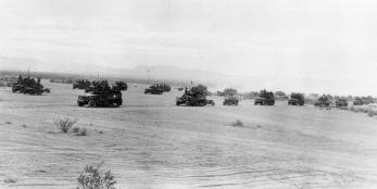 Historical photo of tanks in action at the World War II Desert Training Center.  BLM Photo